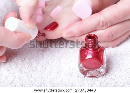 Close up of female feet with red polished nails carefree, chiropody - stock photo