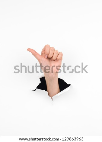 close-up of female hand coming out from a hole in a paper, counting number one gesture, isolated on white