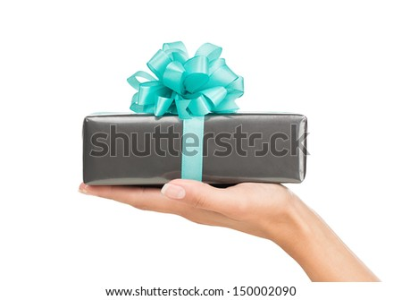 Close up of female hand holding gift box isolated on white background - stock photo