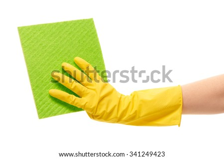 Close up of female hand in yellow protective rubber glove holding green rag against white background