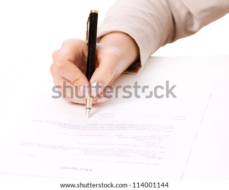 Close up of female hand signing a contract, mortgage - stock photo