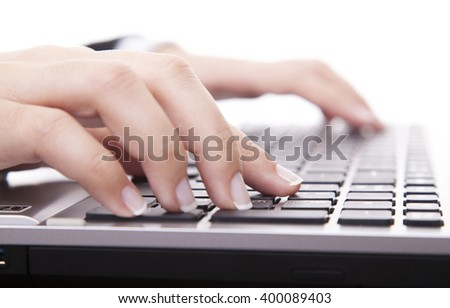 Close-up of female hand touching buttons of computer keyboard