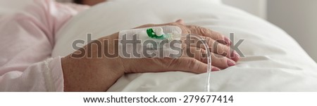 Close-up of female hand with venous catheter - stock photo