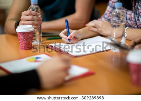 Close up of female hand writing her task - stock photo