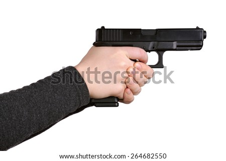Close up of female hands aiming gun on a white background - stock photo