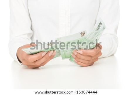Close up of female hands counting money isolated on white background - stock photo