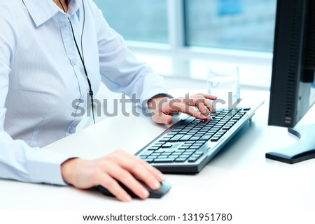 Close-up of female hands during computer work - stock photo