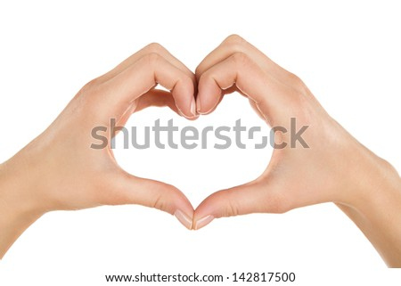 Close up of female hands making heart shape isolated on white background - stock photo