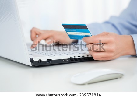 Close up of female hands making online payment - stock photo