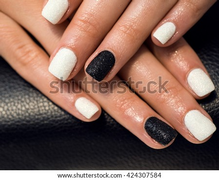 Close up of female hands showing colorful nail polish. - stock photo