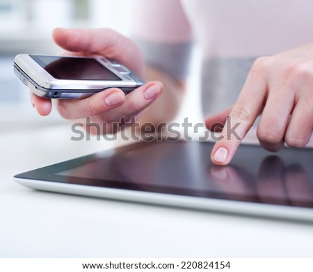 Close-up of female hands touching digital tablet  - stock photo