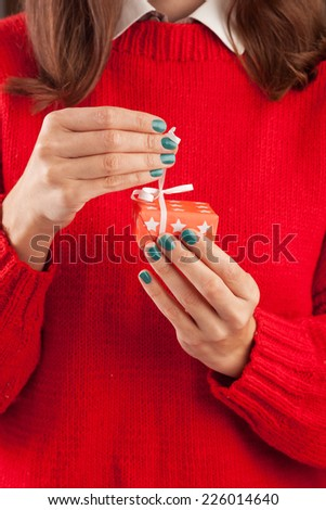 Close-up of female hands unpacking a present - stock photo