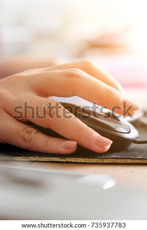 Close-up of female hands using laptop computer, working on laptop