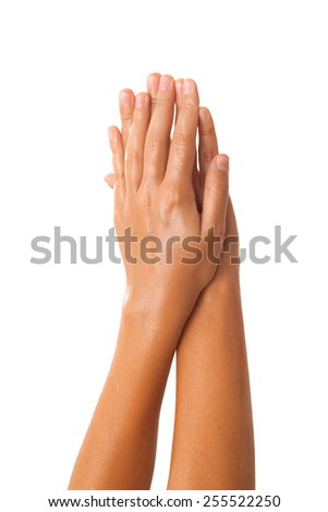 Close-up of female hands while applying oil on white background view 6 - stock photo