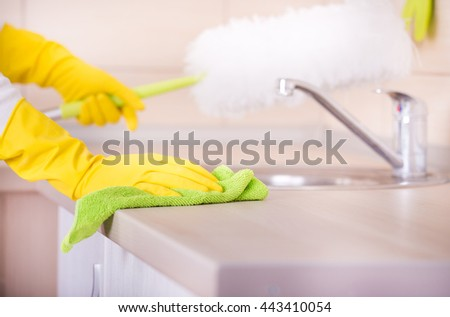 Kitchen Counter Close Up closeup woman hand cleaning stainless steel stock photo 555960268