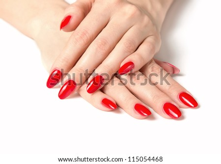 Close up of female hands with red fingernails isolated on white background - stock photo