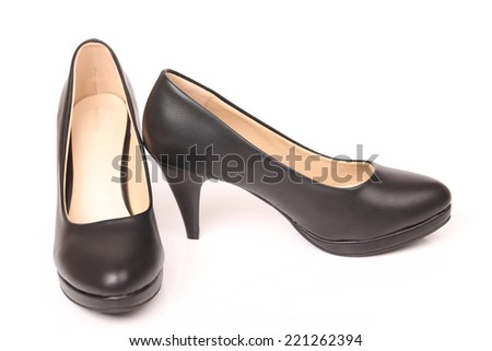 Close-up of female high-heeled shoes over white background