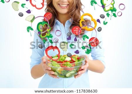 Close-up of female holding bowl with fresh salad - stock photo