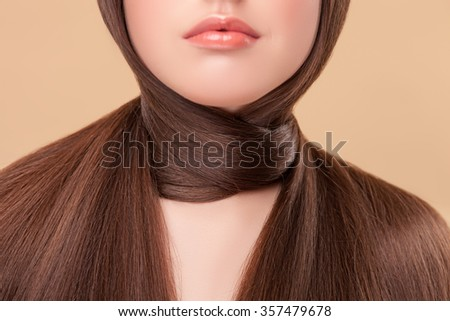 Close up of female neck with long smooth hair around as scarf. The woman is standing with confidence - stock photo