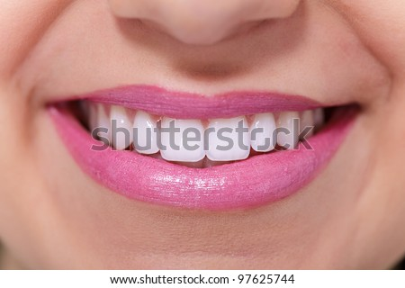 Close up of female perfectly white healthy toothy smile. - stock photo
