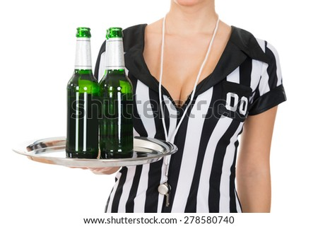 Close-up Of Female Referee Holding Drinks With Tray Over White Background - stock photo