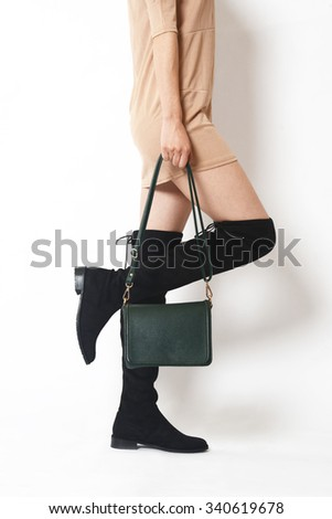 close up of female sexy legs and high heel boots - stock photo