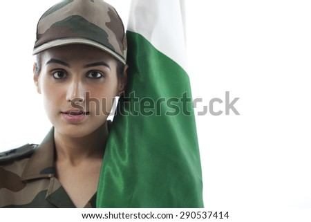 Close-up of female soldier with Indian flag against white background - stock photo