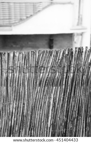 Close up of fence made of tree twigs in black and white