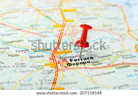 Close up of  Ferrara , Italy map with red pin    - Travel concept