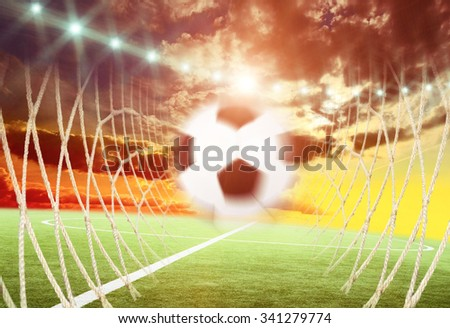Close up of field with the soccer ball on the line - stock photo