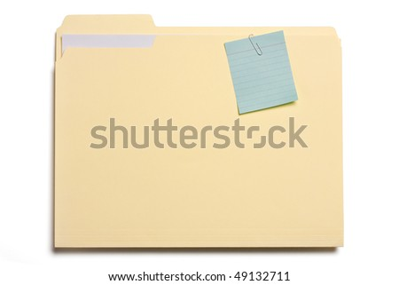 Close up of file folder with blue note pad clipped on it. - stock photo