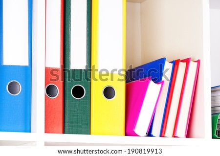 Close-up of file folders on the shelves at office