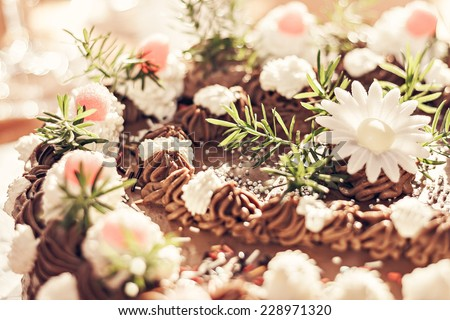close up of filled chocolate cake with flower - vintage image - stock photo