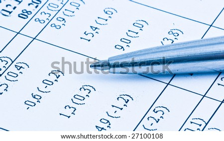Close up of financial figures and pen