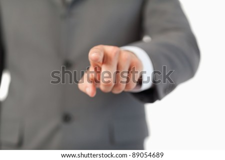 Close up of finger pressing a invisible touchscreen against a white background
