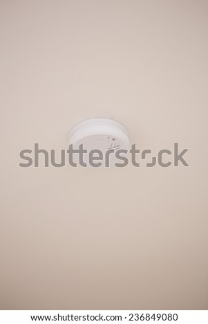 Close up of fire detector on the ceiling - stock photo