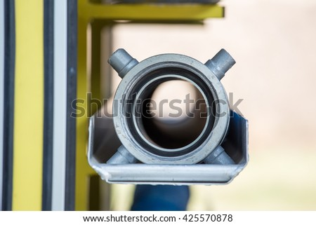 close up of fire hose adapter on fire truck - stock photo
