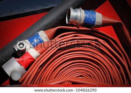 Close up of fire hoses on a fire truck, selective focus. - stock photo