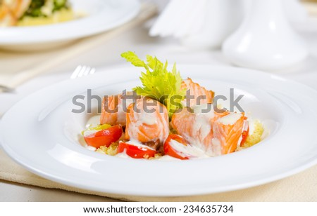 Close Up of Fish and Cream Dish on Restaurant Table - stock photo