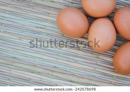 Close up of five eggs on thai traditional mat for cook, with copyspace - stock photo