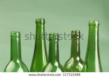 Close-up of five empty bottles