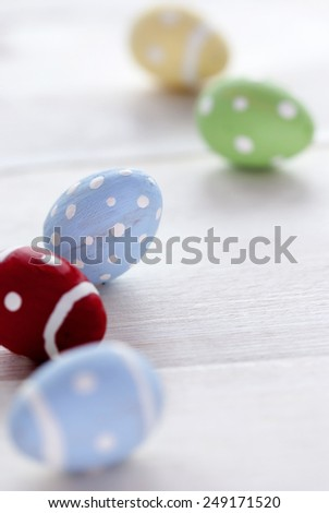 Close Up Of Five Or Many Colorful Easter Eggs On Wooden Background Which Are Dotted And Striped Vintage Shabby Chic Or Retro Style For Easter Greetings With Copy Space Free Text Or Your Text Here - stock photo