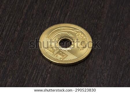 close up of five yen - stock photo