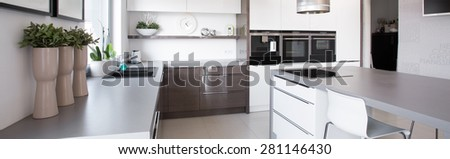 Close-up of floral decorations in new clean kitchen - stock photo