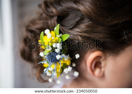 Close up of flowers in women's hair for wedding - stock photo