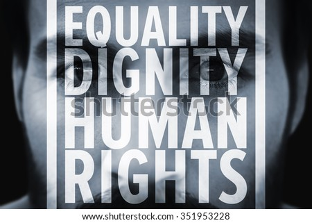 Close up of focused businessman against human rights - stock photo