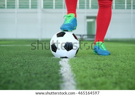 Close up of foot on top of soccer ball on the line