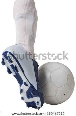 Close up of football player kicking ball on white background