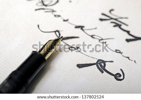 Close up of fountain pen on old letter - stock photo
