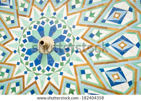 close-up of fountain with moroccan mosaic tiles - stock photo